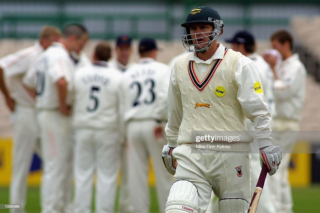 Darren Maddy of Leicestershire heads back to the pavilion after losing his wicket to Peter Martin of Lancashire for 66 during the Frizzell County Championship match between Lancashire and Leicestershire at Old Trafford, Manchester. DIGITALIMAGE Mandatory Credit: Mike Finn Kelcey/Getty Images