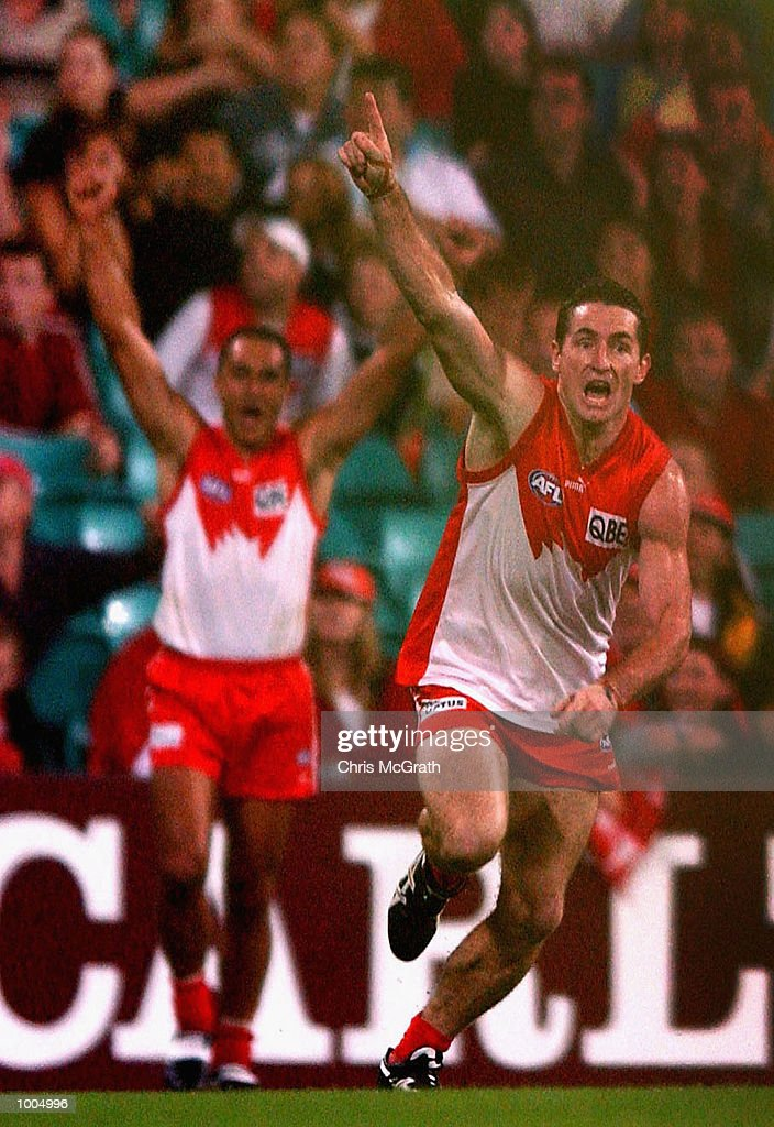 Daryn Cresswell #8 of the Swans celebrates after kicking a gial after the siren to win the match for the swans during the round 4 AFL match between the Sydney Swans and the Kangaroos held at the Sydney Cricket Ground, Sydney, Australia. DIGITAL IMAGE. Mandatory Credit: Chris McGrath/Getty Images