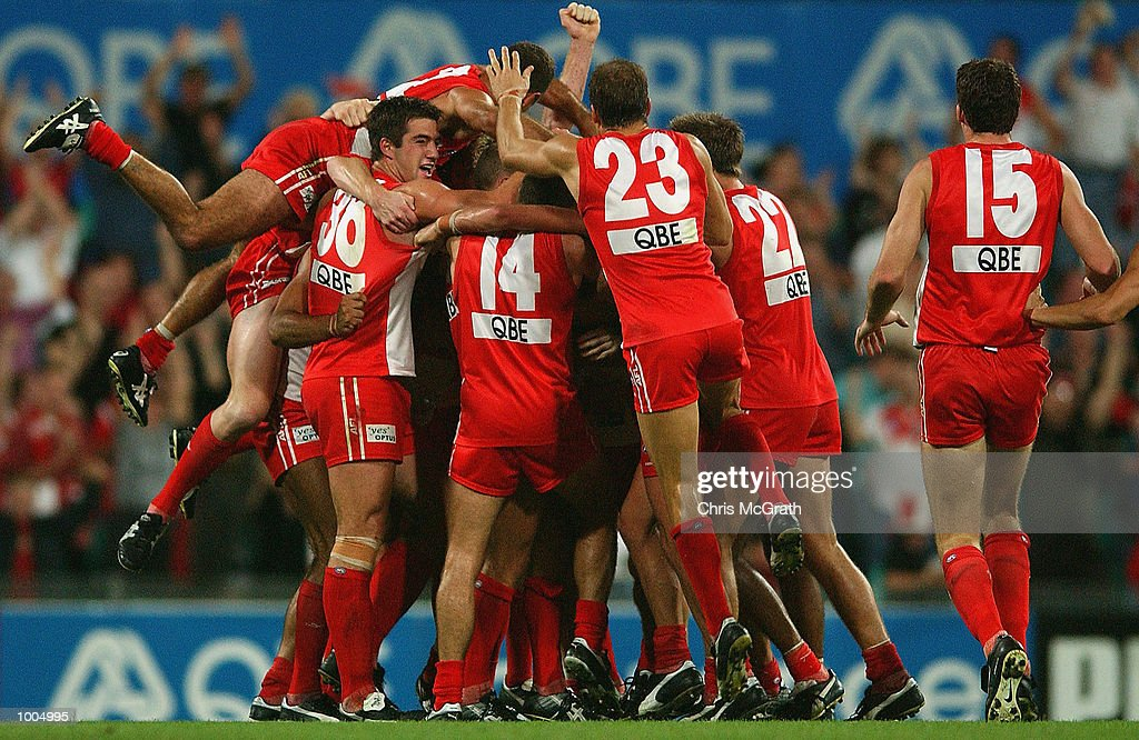 Daryn Creswell #8 is mobbed by team mates after he kicked a goal after the siren to win the match during the round 4 AFL match between the Sydney Swans and the Kangaroos held at the Sydney Cricket Ground, Sydney, Australia. DIGITAL IMAGE.Mandatory Credit: Chris McGrath/Getty Images