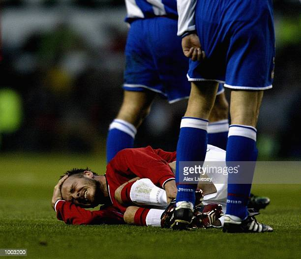 David Beckham of United holds his leg during the UEFA Champions League Quarter Final Second Leg match between Manchester United and Deportivo La...