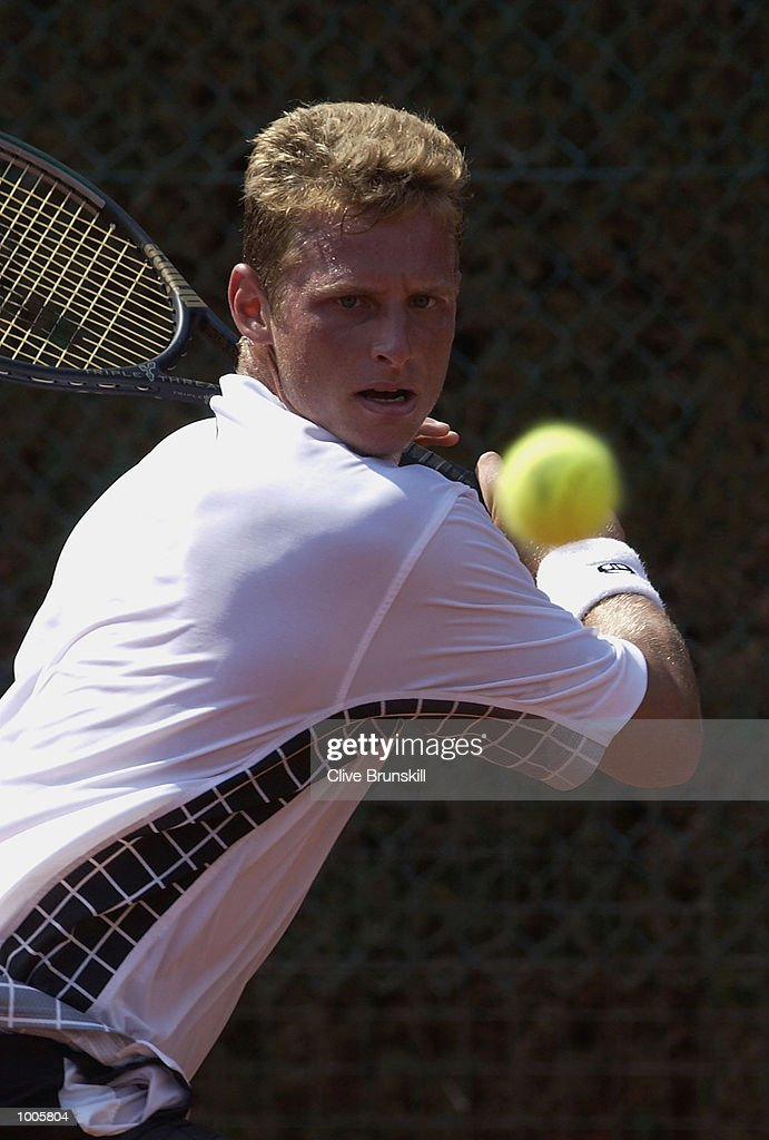David Nalbandian of Argentina plays a backhand during his first round match against Adrian Voinea of Romainia during the Open Seat Godo 2002 held in Barcelona, Spain. DIGITAL IMAGE Mandatory Credit: Clive Brunskill/Getty Images