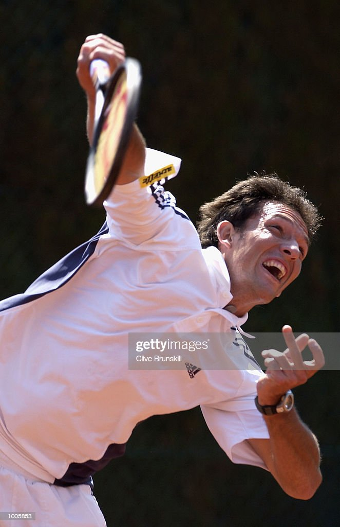 David Sanchez of Spain serves in his first round match against Mariano Zabaleta of Argentina during the Open Seat Godo 2002 held in Barcelona, Spain. DIGITAL IMAGE Mandatory Credit: Clive Brunskill/Getty Images