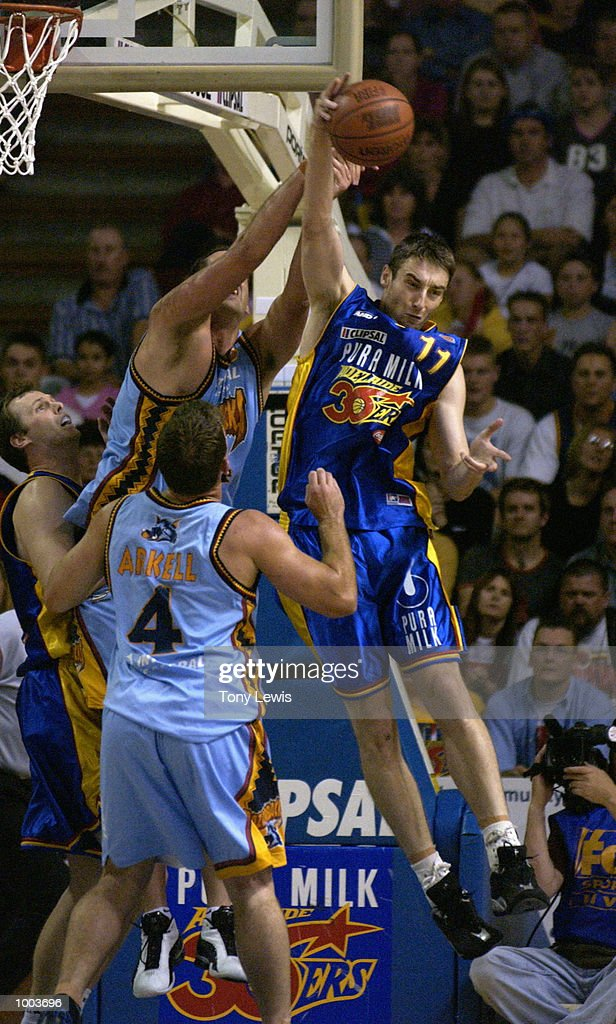 David Stiff #11 for the 36ers knocks a rebound away from the Razorback goal in game 1 of the NBL grand finals between the Adelaide 36ers and the West Sydney Razorbacks played at Clipsal Powerhouse in Adelaide, Australia. Digital Image Mandatory Credit: Tony Lewis/Getty Images