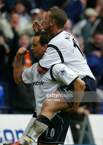 Dean Holdsworth of Bolton celebrates his goal with Kevin Nolan during the Barclaycard Premier League match between Bolton Wanderers and Tottenham...