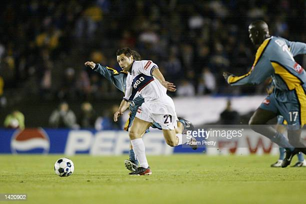 Dema Kovalenko of the Chicago Fire dribbles against the defense of Ezra Hendrickson of the Los Angeles Galaxy during the MLS match at the Rose Bowl...