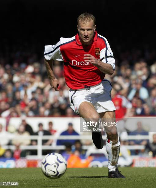 Dennis Bergkamp of Arsenal runs with the ball during the FA Barclaycard Premiership match between Arsenal and Tottenham Hotspur played at Highbury in...