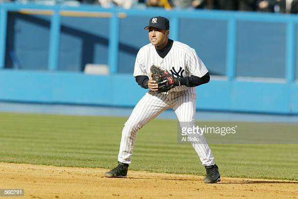 Derek Jeter of the New York Yankees during the game against the Tampa Bay Devil Rays at Yankee Stadium in the Bronx New York The Yankees won 30...