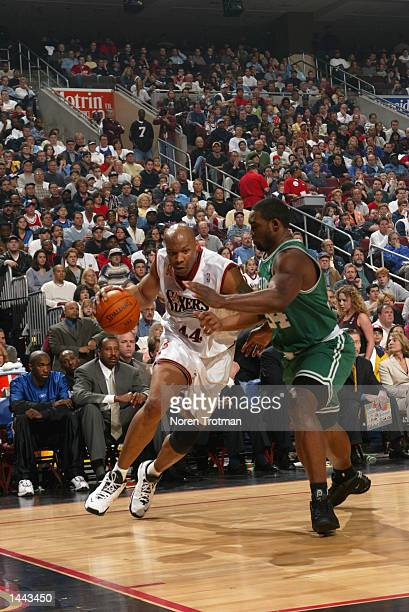 Derrick Coleman of the Philadelphia 76ers drives against Paul Pierce of the Boston Celtics during Game 3 of the Eastern Conference quarterfinals...