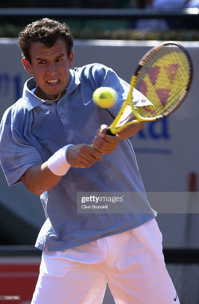 Dominik Hrbaty of Slovakia plays a backhand during his first round match against Feliciano Lopez of Spain during the Open Seat Godo, Barcelona, Spain . DIGITAL IMAGE Mandatory Credit: Clive Brunskill/Getty Images