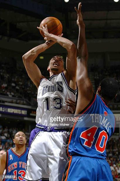 Doug Christie of the Sacramento Kings powers the ball to the basket versus Kurt Thomas of the New York Knicks at the ARCO Arena in Sacramento...