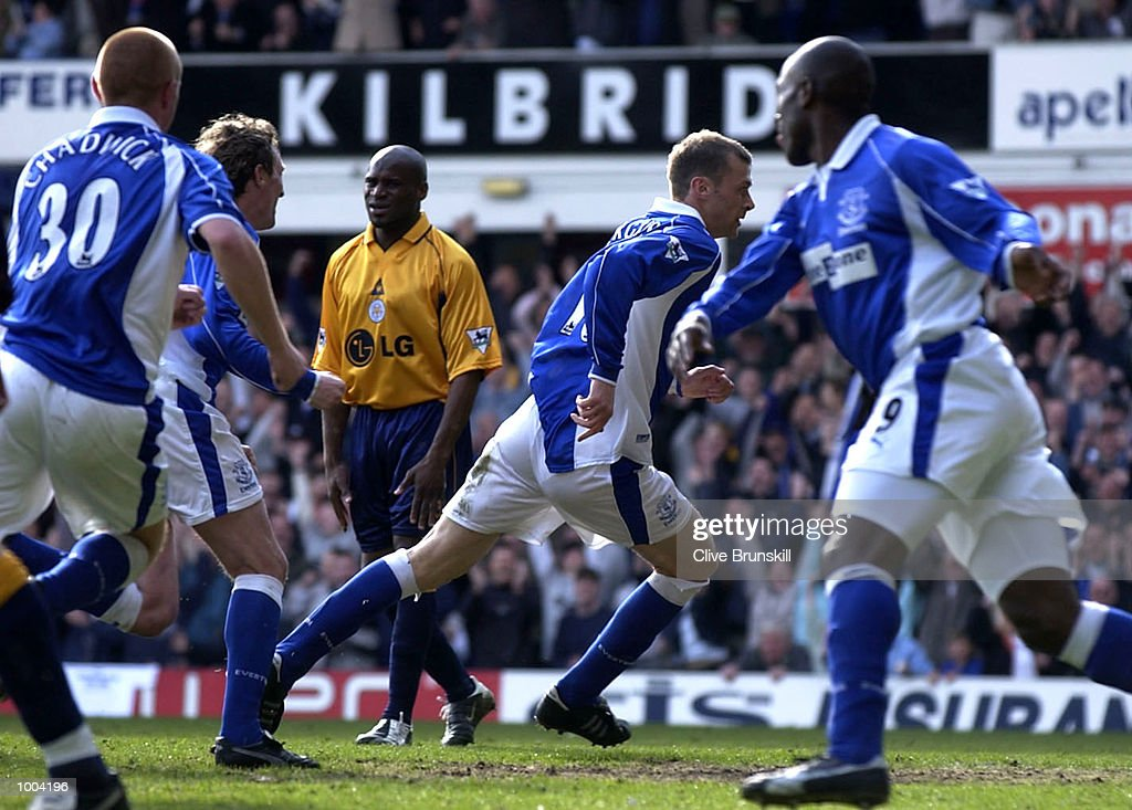 Ducan Ferguson of Everton (centre) wheels away to celebrate scoring the second goal as Frank Sinclair of Leicester shows his disappointment during the Everton v Leicester City FA Barclaycard Premiership match at Goodison Park, Everton. DIGITAL IMAGE Mandatory Credit: CLIVE BRUNSKILL/Getty Images