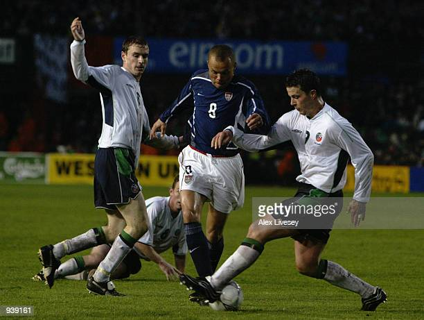 Earnie Stewart of the USA is tackled by Ian Harte and Colin Healey of Republic of Ireland during the International Friendly match played at Lansdowne...