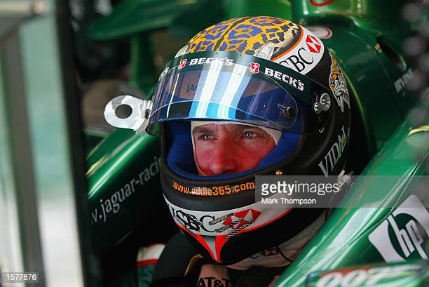 Eddie Irvine of Northern Ireland and Jaguar checks his lap times during first practice for the Formula One Spanish Grand Prix at the Circuit de...
