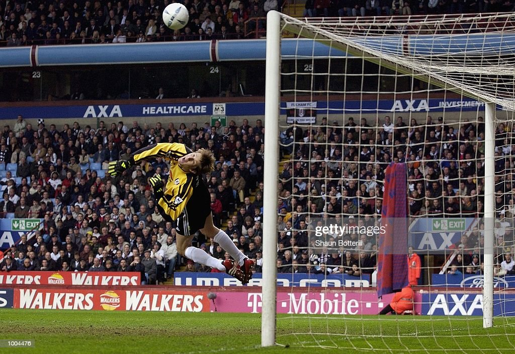 Edwin van der Sar of Fulham saves from John Terry of Chelsea (not in photo) during the Axa FA Cup Semi Final match between Chelsea and Fulham at Villa Park, Birmingham. DIGITAL IMAGE. Mandatory Credit: Shaun Botterill/Getty Images