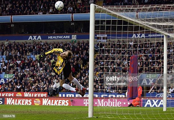 Edwin van der Sar of Fulham saves from John Terry of Chelsea during the Axa FA Cup Semi Final match between Chelsea and Fulham at Villa Park,...
