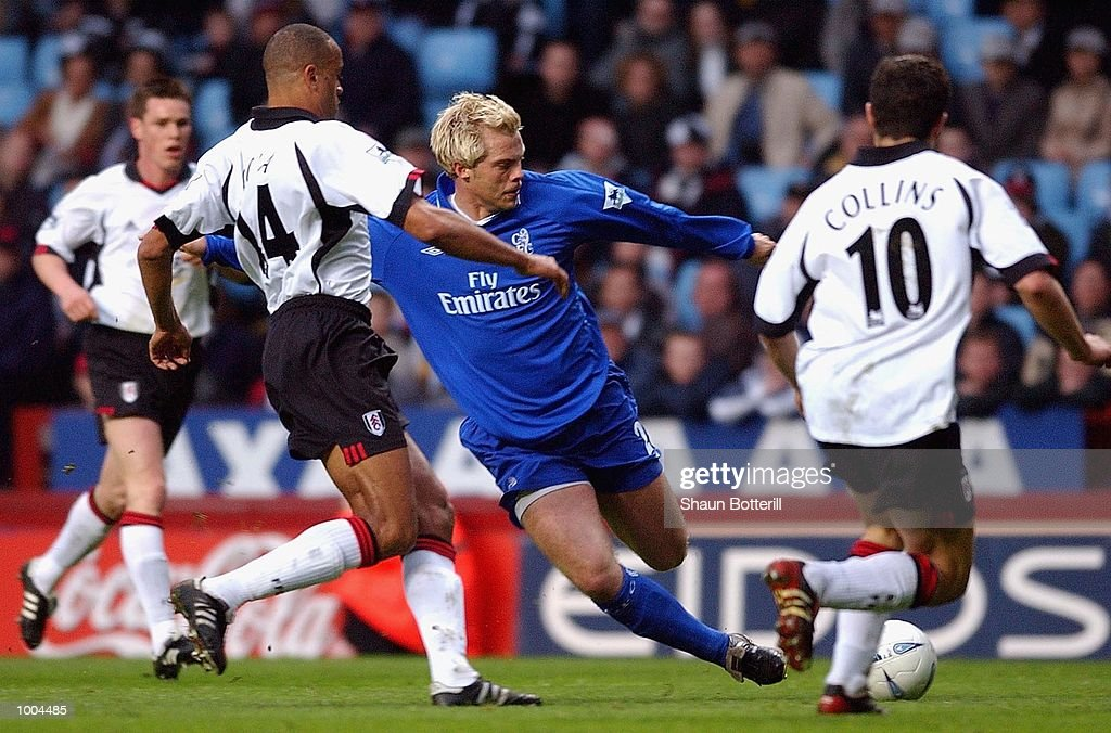 Eidur Gudjohnsen of Chelsea takes on Steed Malbranque and John Colins of Fulham during the Axa FA Cup Semi Final match between Chelsea and Fulham at Villa Park, Birmingham. DIGITAL IMAGE. Mandatory Credit: Shaun Botterill/Getty Images