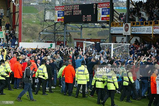 Fans celebrate as Igor Balis of West Brom scores a penalty to win the Nationwide Division One match between Bradford City and West Bromwich Albion at...