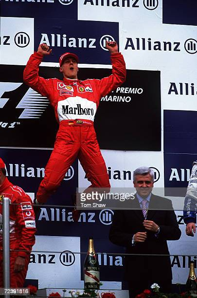 Ferrari driver Michael Schumacher of Germany celebrates on the podium after winning the San Marino Formula One Grand Pix held in Imola Italy...