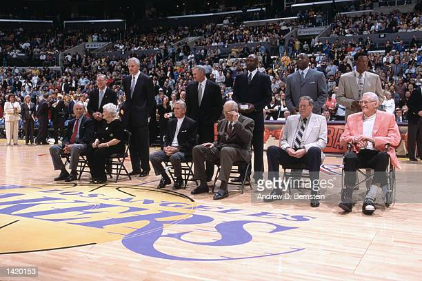 Former Minnesota and Los Angeles Lakers gather on center court before the NBA game between the Minnesota Timberwolves and the Los Angeles Lakers at...