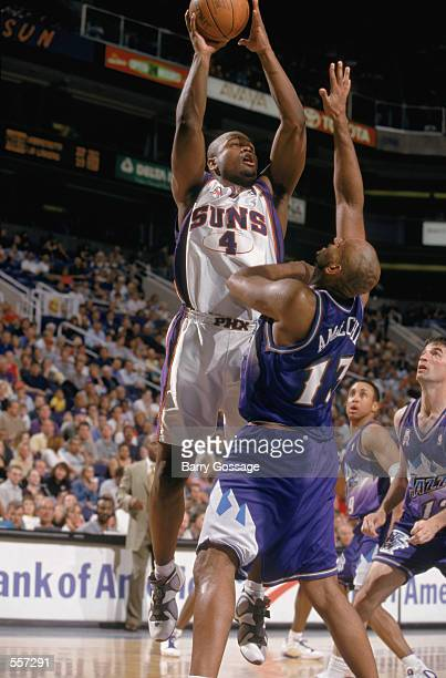 Forward Alton Ford of the Phoenix Suns shoots the ball over center John Amaechi of the Utah Jazz during the NBA game at the American Airlines Arena...