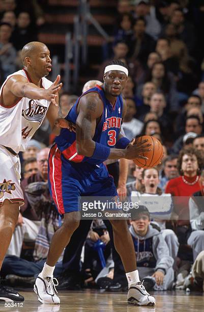 Forward Ben Wallace of the Detroit Pistons posts up forward Derrick Coleman of hte Philadelphia 76ers during the NBA game at the First Union Center...