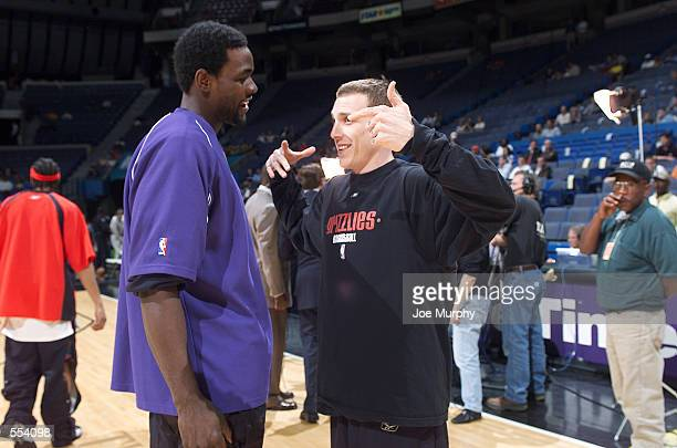 Forward Chris Webber of the Sacramento Kings catches up with former teammate point guard Jason Williams now of the Memphis Grizzlies before the NBA...