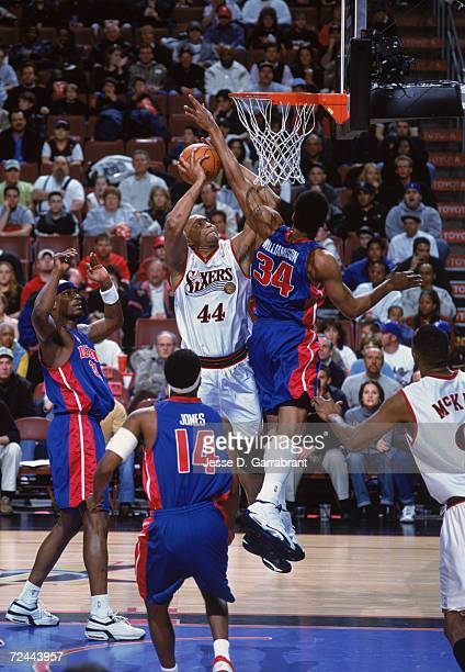 Forward Derrick Coleman of the Philadelphia 76ers shoots the ball over forward Corliss Williamson of the Detroit Pistons during the NBA game at the...