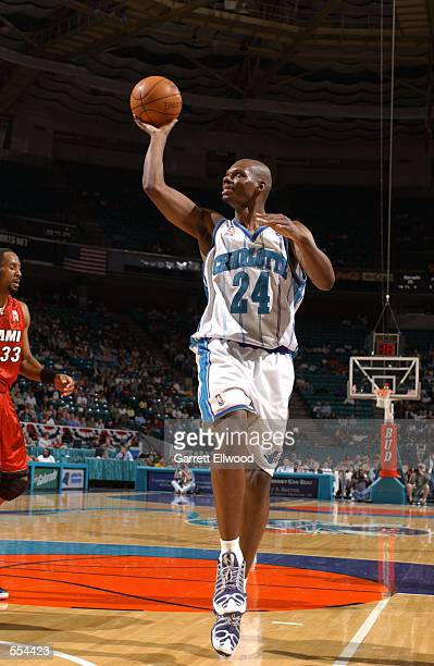 Forward Jamal Mashburn of the Charlotte Hornets flips a shot during the NBA game against the Miami Heat at Charlotte Coliseum in Charlotte North...