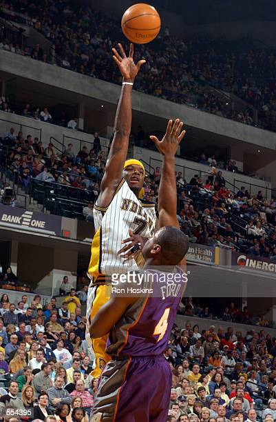 Forward Jermaine O''Neal of the Indiana Pacers shoots over forward Alton Ford of the Phoenix Suns during the NBA game at Conseco Fieldhouse in...