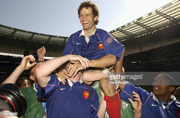 France captain Fabien Galthie is carried by his players as they celebrate winning the grand slam after the Lloyds TSB Six Nations Championship match...