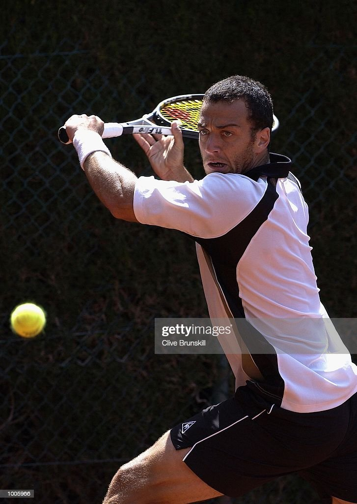 Franco Squillari of Argentina plays a backhand during his second round match against Arnaud Clement of France during the Open Seat Godo 2002 held in Barcelona, Spain. DIGITAL IMAGE Mandatory Credit: Clive Brunskill/Getty Images