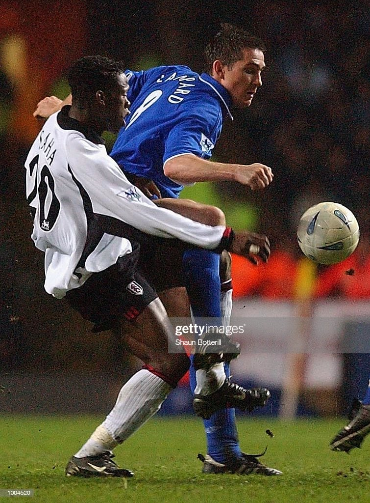 Frank Lampard of Chelsea holds off the challenge of Louis Saha of Fulham during the Axa FA Cup Semi Final match between Chelsea and Fulham at Villa Park, Birmingham. DIGITAL IMAGE. Mandatory Credit: Shaun Botterill/Getty Images