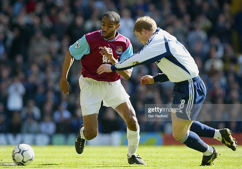 Frederic Kanoute of West Ham and Ben Thatcher of Tottenham Hotspur in action during the FA Barclaycard Premiership match between Tottenham Hotspur and West Ham United at White Hart Lane, London. DIGITAL IMAGE Mandatory Credit: Ben Radford/Getty Images
