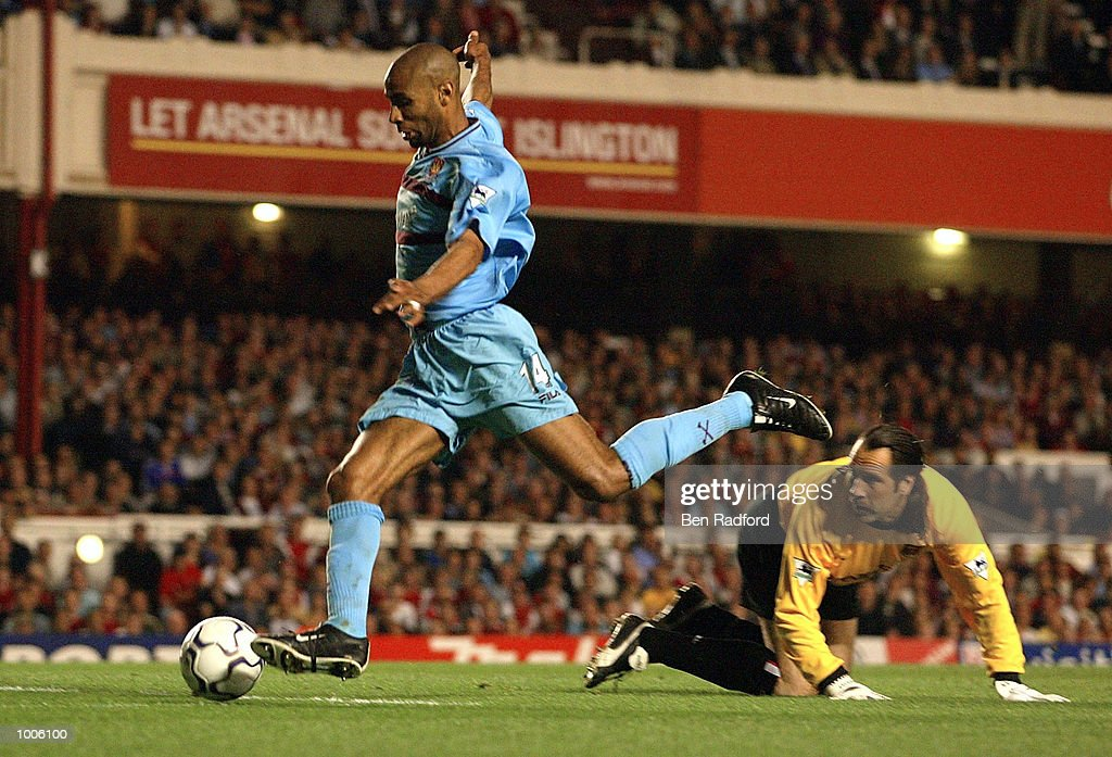 Frederic Kanoute of West Ham goes around David Seaman of Arsenal as Ashley Cole clears the ball off the line during the FA Barclaycard Premiership match between Arsenal and West Ham United at Highbury, London. DIGITAL IMAGE Mandatory Credit: Ben Radford/Getty Images