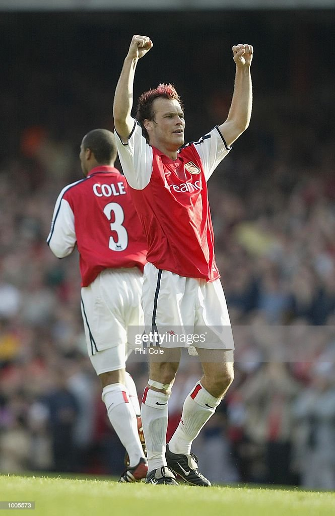 Fredrik Ljungberg of Arsenal celebrates scoring the 2nd goal during the FA Barclaycard Premiership match between Arsenal and Ipswich Town at Highbury, London. DIGITAL IMAGE Mandatory Credit: Phil Cole/Getty Images