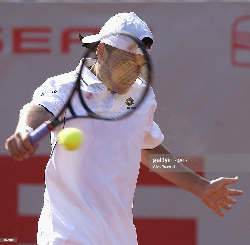 Galo Blanco of Spain plays a backhand during his second round match against Alex Corretja of Spain during the Open Seat Godo 2002 held in Barcelona, Spain. DIGITAL IMAGE Mandatory Credit: Clive Brunskill/Getty Images