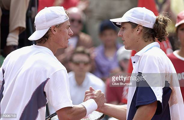 Gaston Gaudio of Argentina shakes hands at the net after his victory in the semifinal over world no1 Lleyton Hewitt of Australia during the Open Seat...