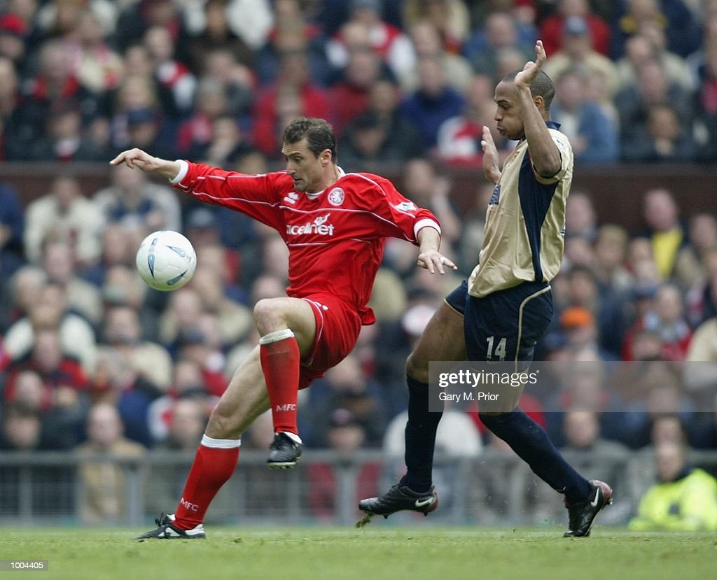 Gianluca Festa of Boro holds off Thierry Henry of Arsenal during the AXA sponsored FA Cup semi final tie between Middlesbrough v Arsenal at Old Trafford Stadium, Manchester. DIGITAL IMAGE. Mandatory Credit: Gary M. Prior/Getty Images