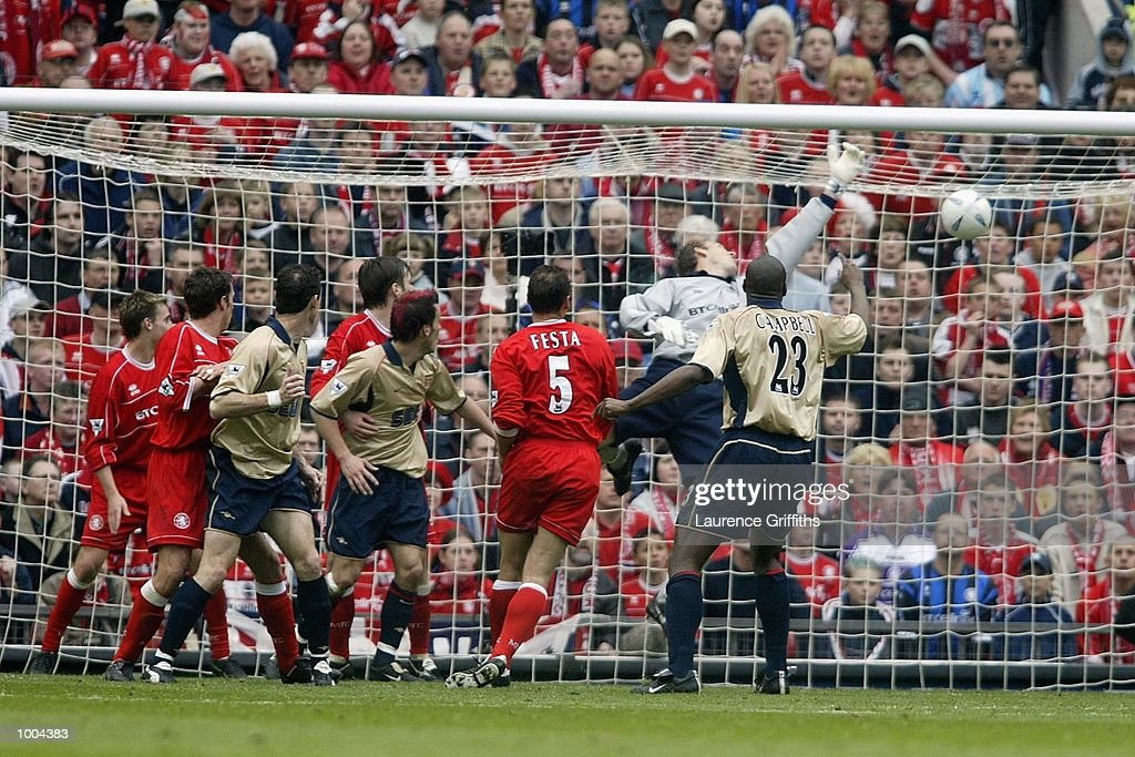 Gianluca Festa of Boro scores an own goal for Arsenal during the AXA sponsored FA Cup semi final tie between Middlesbrough v Arsenal at Old Trafford Stadium, Manchester. DIGITAL IMAGE. Mandatory Credit: Laurence Griffiths/Getty Images