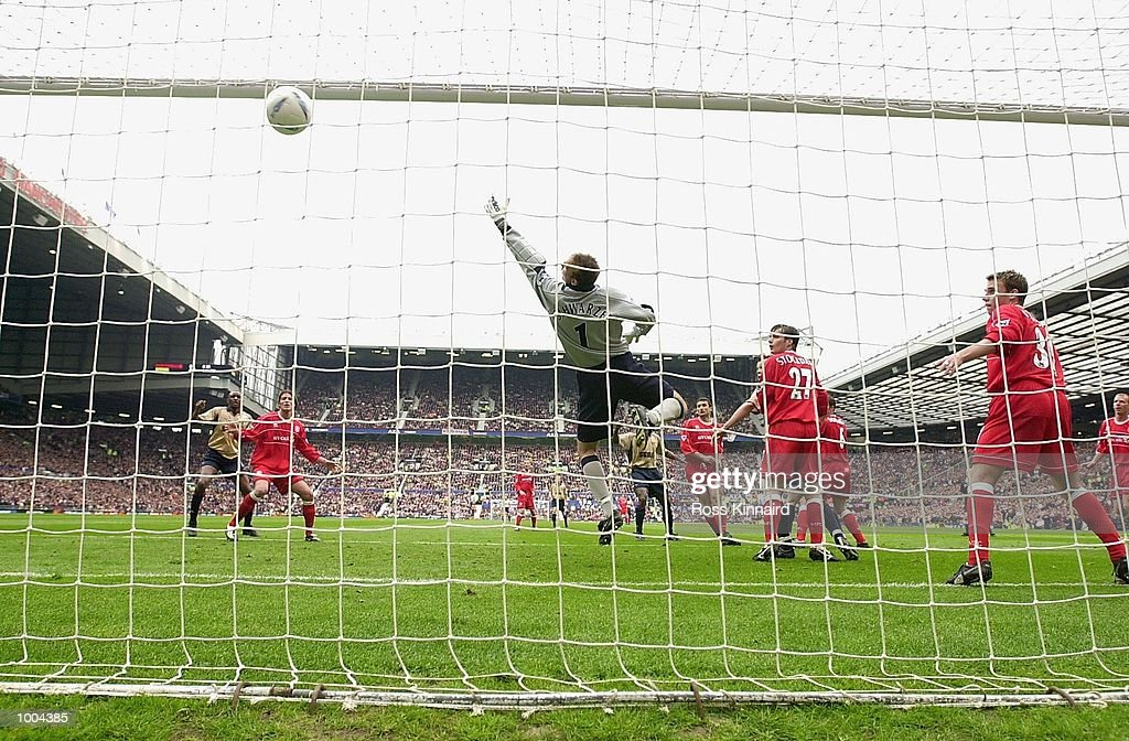 Gianluca Festa of Middlesbrough scores an own goal past goalkeeper Mark Schwarzer during the AXA FA Cup Semi Final between Arsenal and Middlesbrough at Old Trafford, Manchester. DIGITAL IMAGE. Mandatory Credit: Ross Kinnaird/Getty Images
