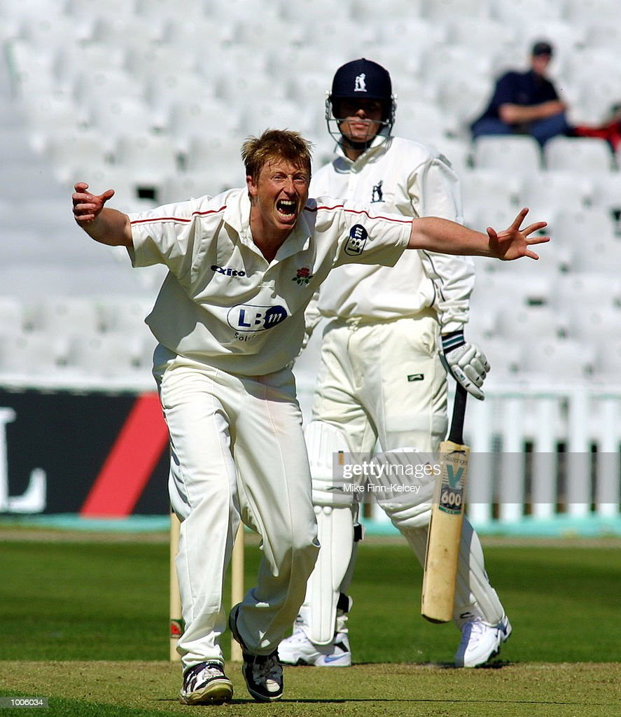 Glen Chapple of Lancashire dismisses Shaun Pollock of Warwickshire during the Frizzell County Championship match between Warwickshire and Lancashire at Edgbaston, Birmingham. DIGITAL IMAGE Mandatory Credit: Mike Finn Kelcey/Getty Images