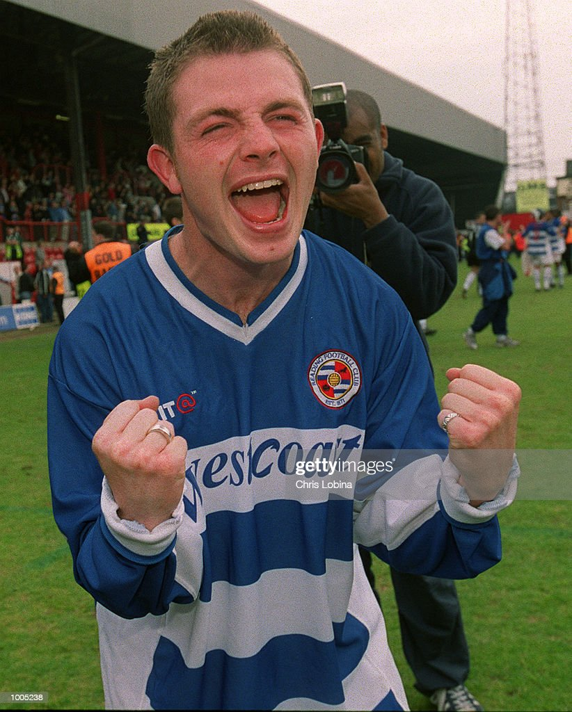 Goal-scorer Jamie Cureton celebrates as Reading clinch promotion after the Nationwide Division Two match between Brentford and Reading at Griffin Park, Brentford, London. Mandatory Credit: Chris Lobina/Getty Images