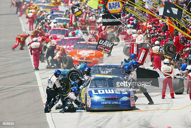 Gordon Racing driver Jimmie Johnson makes a pitstop in his Chevrolet Monte Carlo during the NASCAR Winston Cup Series NAPA Auto Parts 500 at the...