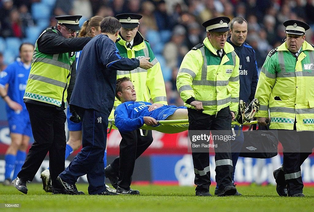 Graeme Le Saux of Chelsea is carried off injured during the Axa FA Cup Semi Final match between Chelsea and Fulham at Villa Park, Birmingham. DIGITAL IMAGE. Mandatory Credit: Ben Radford/Getty Images
