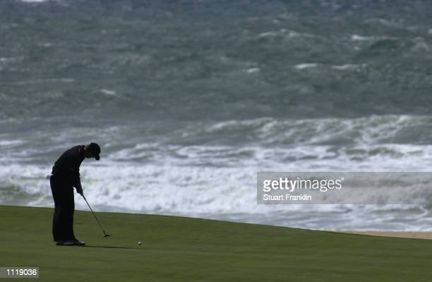 Graeme Storm of England putts towards the Atlantic Ocean on the 15th green during the 2nd round of the Algrave Portuguese Open at Vale De Lobo Faro...