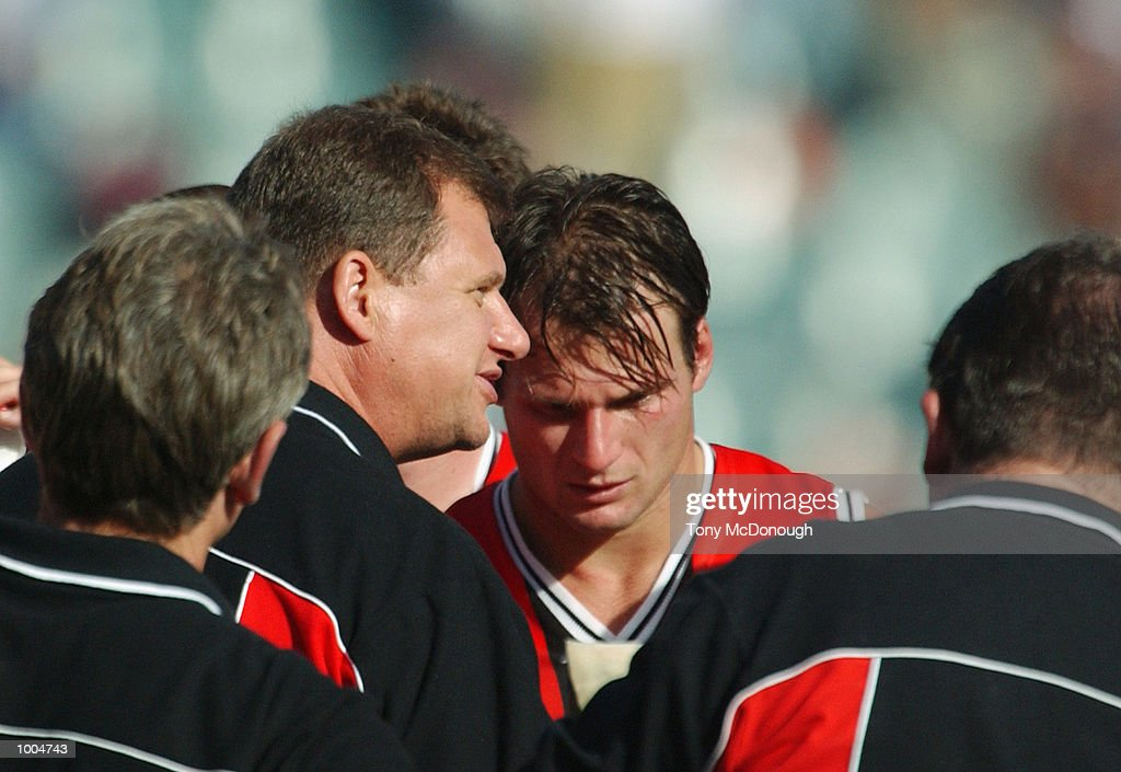 Grant Thomas, coach for St Kilda speaks to his team at quarter time during the round two AFL match between the Fremantle Dockers and St Kilda Saints played at Subiaco Oval in Western Australia.Mandatory Credit: Tony McDonough/Getty Images