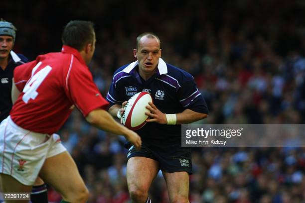 Gregor Townsend of Scotland looks to take the ball past Rhys Williams of Wales during the Lloyds TSB Six Nations Championship match played at the...