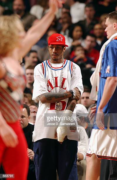 Guard Allen Iverson of the Philadelphia 76ers stands in street clothes during the NBA game against the Phoenix Suns at First Union Center in...