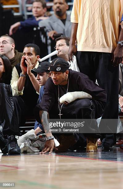Guard Allen Iverson of the Philadelphia 76ers watches the action during the NBA game against the Detroit Pistons at the First Union Center in...