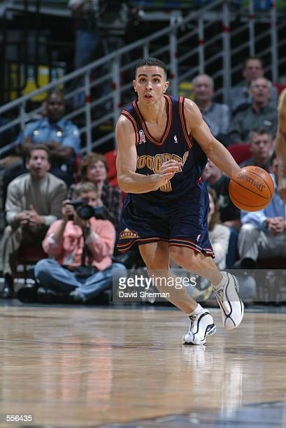 Guard Carlos Arroyo of the Denver Nuggets dribbles the ball during the NBA game against the Minnesota Timberwolves at Target Center in Minneapolis...